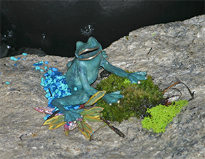 The more time I spent in Sam's garden, the more I noticed. He is a master at tucking little surprises into his designs - like this happy frog sitting in moss and pebbles on a big rock.
