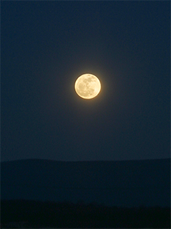 Full moon over the Blue Ridge Mountains.