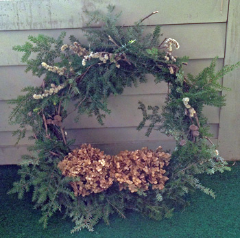 Melissa's wreath of hemlock and dried flowers