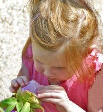 Children can't resist smelling the flowers!